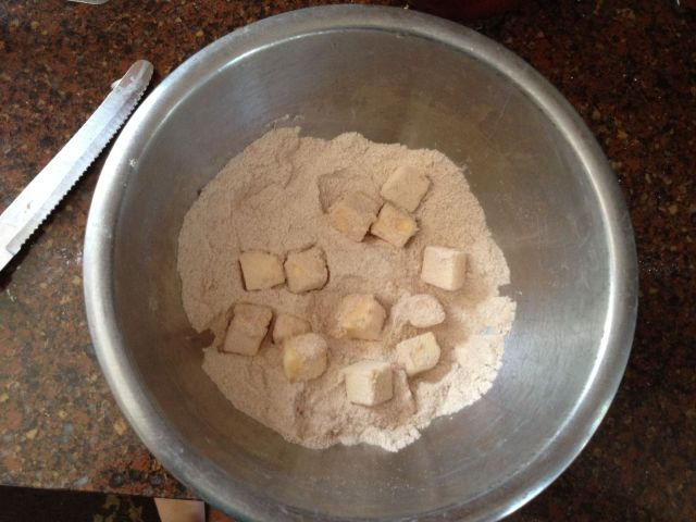 Get the butter nice and coated with the sugar and flour mixture...