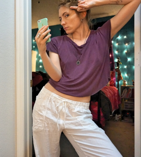34-year-old executive editor of a very famous online publication and overall cool mom, Laneia, is ready for date night in an aubergine crop top with no bra and hoop earrings.