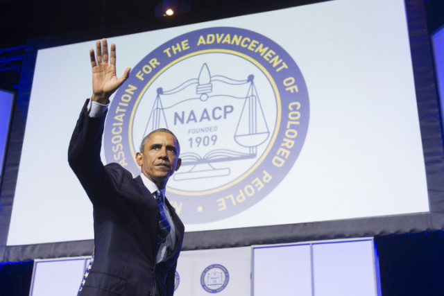 US President Barack Obama waves after speaking during the NAACP's 106th National Convention in Philadelphia, Pennsylvania, July 14, 2015. AFP PHOTO / SAUL LOEBSAUL LOEB/AFP/Getty Images