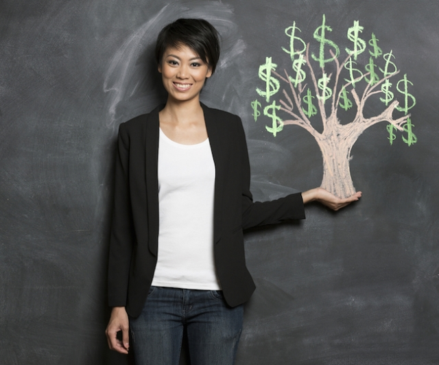 You will be like this stock photo of a woman holding a perfectly balanced money tree once you start dealing with your debt instead of hiding from it. (via Shutterstock)