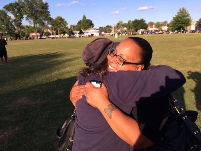 Rebecca O'Hara, Ashton O'Hara's mother receiving a hug from a supporter. via