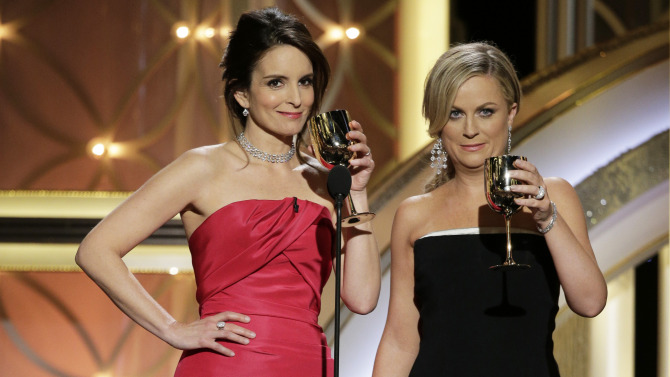 BEVERLY HILLS, CA - JANUARY 12:  In this handout photo provided by NBCUniversal,  Hosts Tina Fey and Amy Poehler speak onstage during the 71st Annual Golden Globe Award at The Beverly Hilton Hotel on January 12, 2014 in Beverly Hills, California.  (Photo by Paul Drinkwater/NBCUniversal via Getty Images)