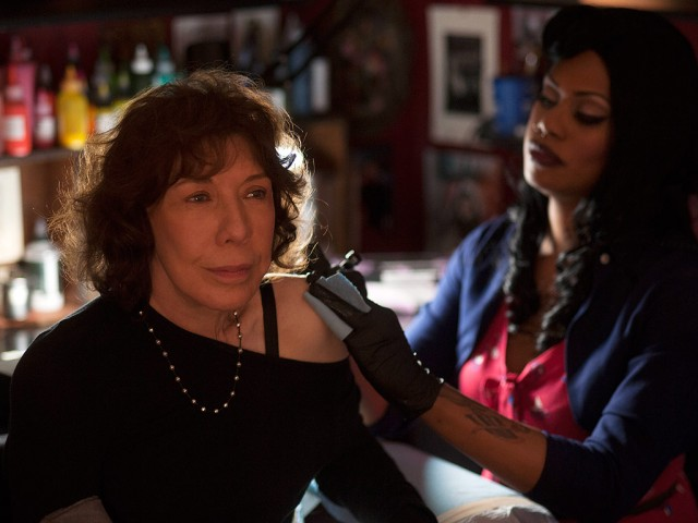 Laverne Cox tattooing Lily Tomlin in a scene from Grandman.