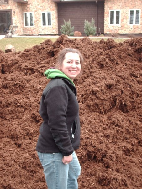 Nikki transferred and made friends while volunteering, and together they moved giant piles of mulch!