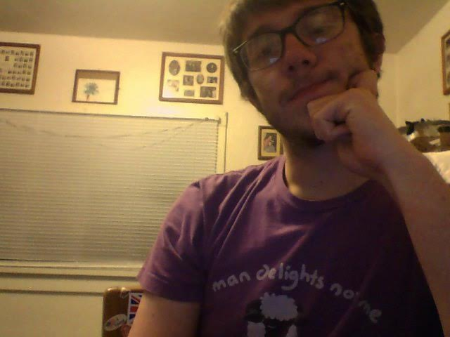 """Here's Pete wearing an asexual pun shirt that says """"Man delights not me no, NOR woman neither,"""" which is both a line from Hamlet and a joke because NOR stands for Non-Oriented Ram, which I guess is a scientific classification for asexual rams. It's also the colors of the Asexual Flag. Jeez, that's a lot of layers"""
