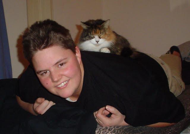 Best friends: a boi and a cat.