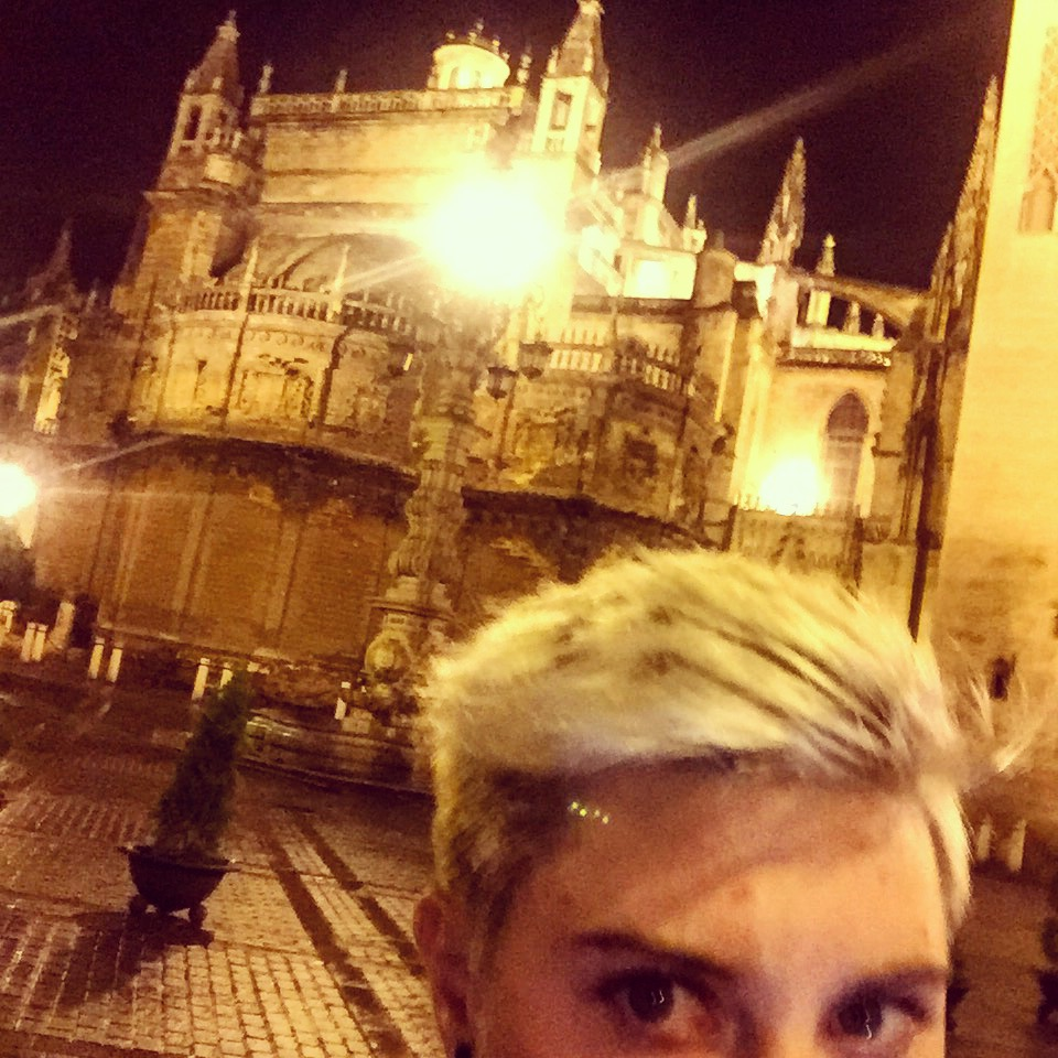 A picture of me and the Seville Cathedral in which you can't really see either.