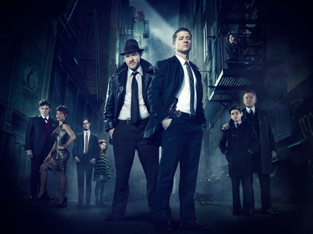 """GOTHAM: GOTHAM traces the rise of the great DC Comics Super-Villains and vigilantes, revealing an entirely new chapter that has never been told. From executive producer/writer Bruno Heller (""""The Mentalist,"""" """"Rome"""") and starring Ben McKenzie (""""Southland,"""" """"The O.C.""""), Jada Pinkett Smith (""""Hawthorne,"""" """"Collateral"""") and Donal Logue (""""Vikings,"""" """"Sons of Anarchy""""), GOTHAM follows one cop, destined for greatness, as he navigates a dangerously corrupt city teetering on the edge of evil, and chronicles the birth of one of the most popular super heroes of our time. GOTHAM will air Mondays (8:00-9:00 PM ET/PT) this fall on FOX. Pictured: (L-R) Robin Lord Taylor, Jada Pinkett Smith, guest star Cory Michael Smith, guest star Clare Foley, Donal Logue, Ben McKenzie, Camren Bicondova, David Mazouz and Sean Pertwee. ©2014 Fox Broadcasting Co. Cr: FOX"""