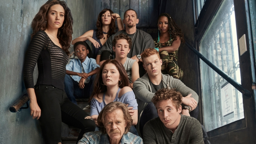 Image: the cast of Shameless sits on a stairwell. Promotional photo.