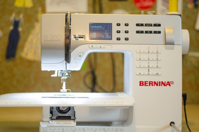 This is the machine I use the most; it's a really fantastic model with a computerized screen, a function for an embroidered alphabet, and dozens of decorative stitches. But most importantly, it can handle sewing through several layers of thick fabric which is useful when I am working with denim, upholstery and leather.