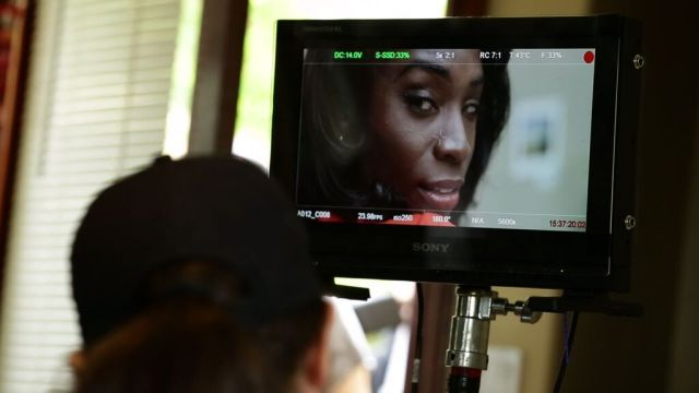 Angelica Ross working on set.