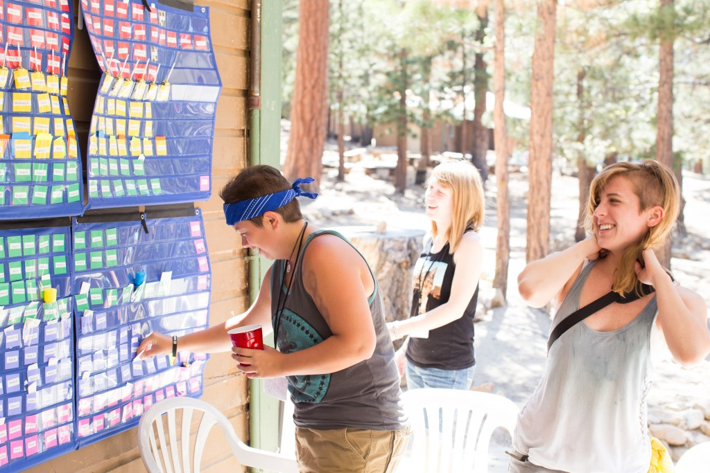 campers putting notes in pigeonholes // photo by Robin Roemer