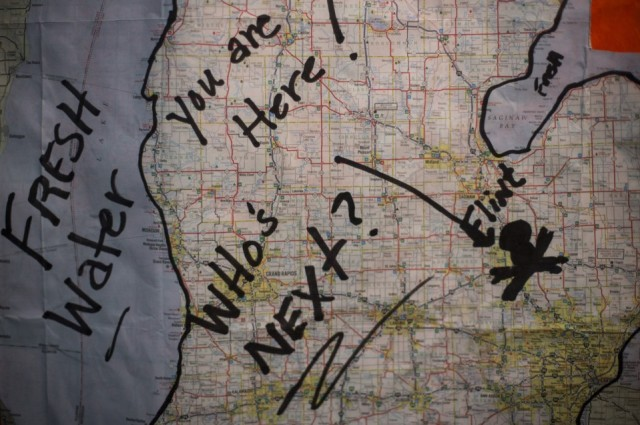 A map previously used during protests against Flint's water quality hangs in the home of area resident Tony Palladeno Jr., 53, on Monday, May 18, 2015 in Flint. Palladeno has been regularly active at protests as well as City Council meetings. Brittany Greeson via MLive.com.