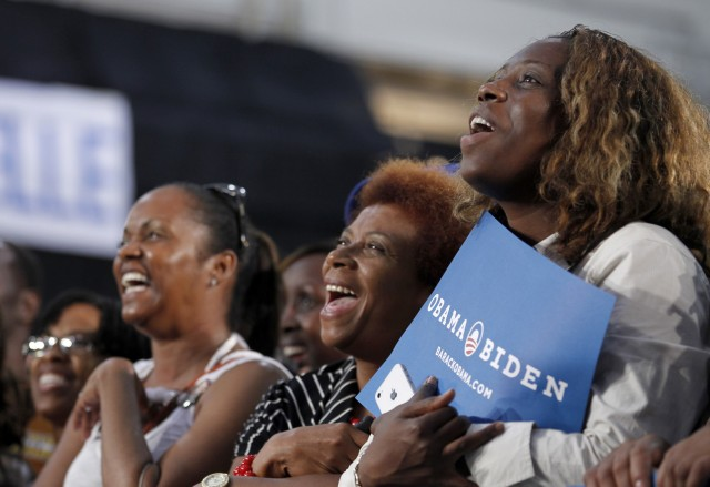Crowd reacts as U.S. first lady Michelle Obama speaks to supporters of Barack Obama's re-election campaign in Fort Lauderdale