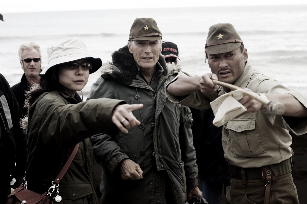 "Director Clint Eastwood, interpreter Yuki Ishimaru, and actor Ken Watanabe on the set of ""Letters From Iwo Jima."""