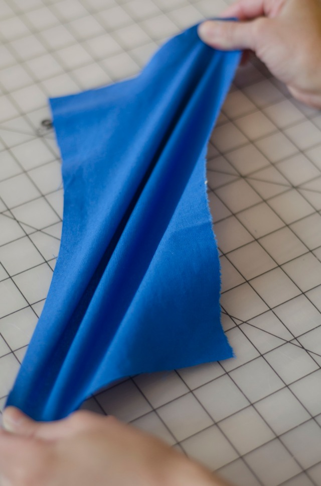 This a woven fabric being stretched on the bias- it doesn't have much stretch when pulled straight up and down or from side to side.