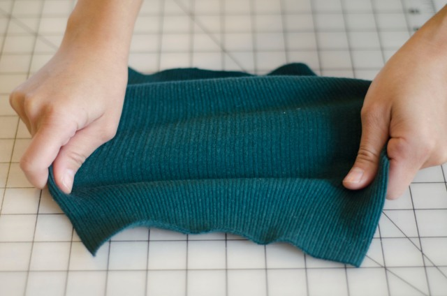 This ribbed knit fabric has a significant amount of stretch when pulled in any direction.