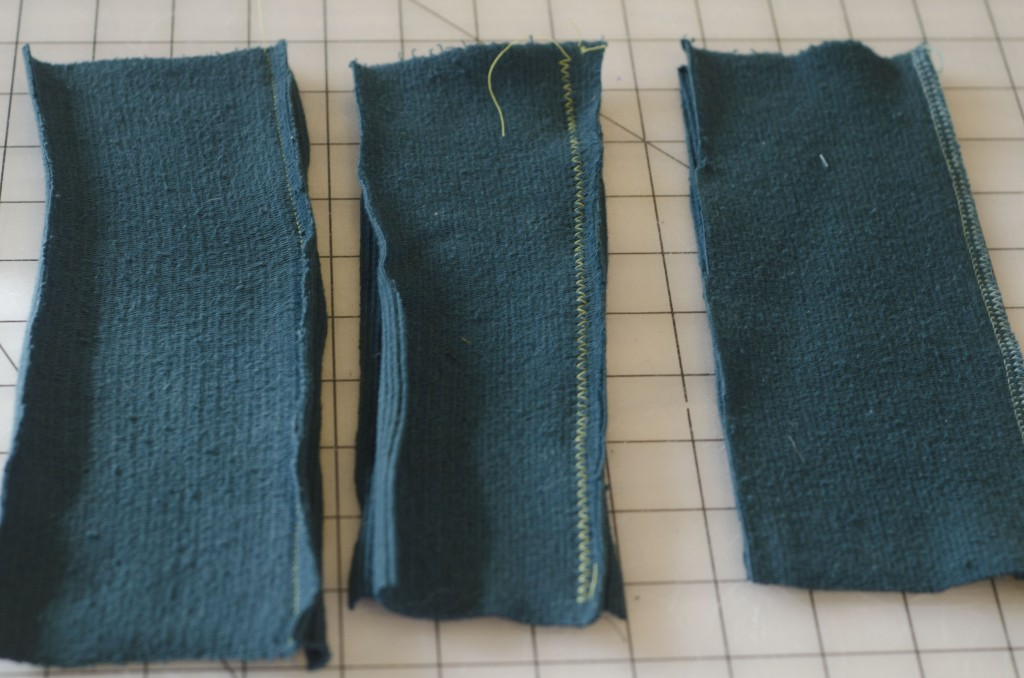 Three different ways to sew knit fabric: from left to right, a straight stitch (not recommended for seams that will need to be stretch out a lot because they may pop open), a zig zag stitch, and a serged seam.