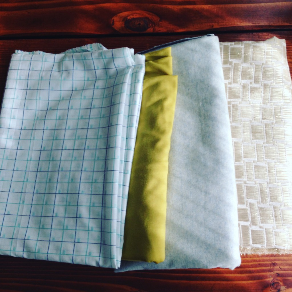 A fabric haul from one of my favorite stores that sources their wool from New Zealand. From left to right, a checkered cotton, a brightly colored knit merino wool, a woven wool blend, and a decorative gold brocade.