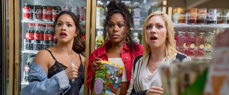 """Someone Great"" still: three women in a gas station looking surprised"