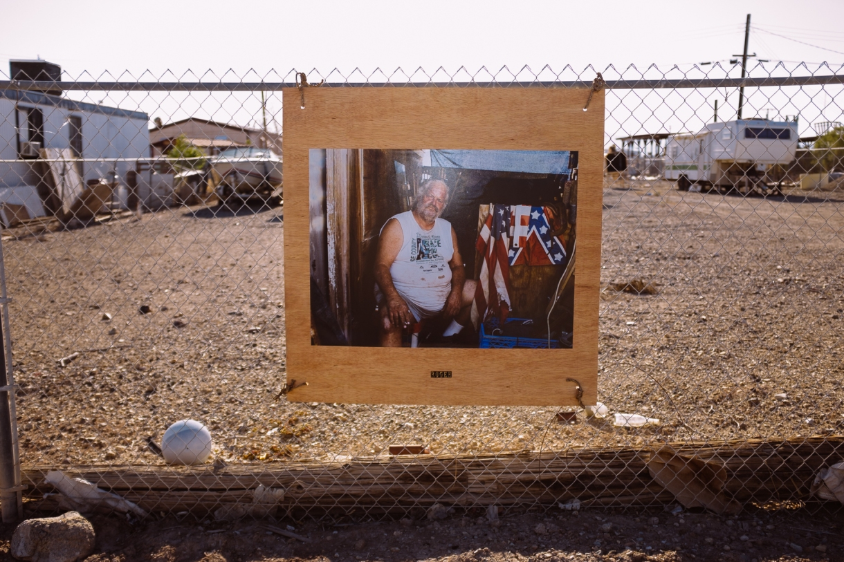 A photographer took and hung photos of the locals outside their properties.