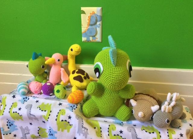 Crochet dinos by IvoryTreeHouse, outlet covers by cathyscraftycovers, receiving blanket from TJ Maxx.