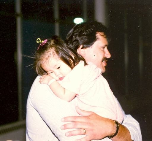 Dad holding me at the airport on June 15, 1984, shortly after we met for the first time.