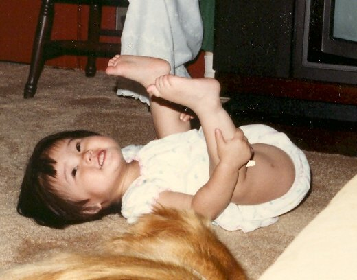 Little me with my doggie friend.
