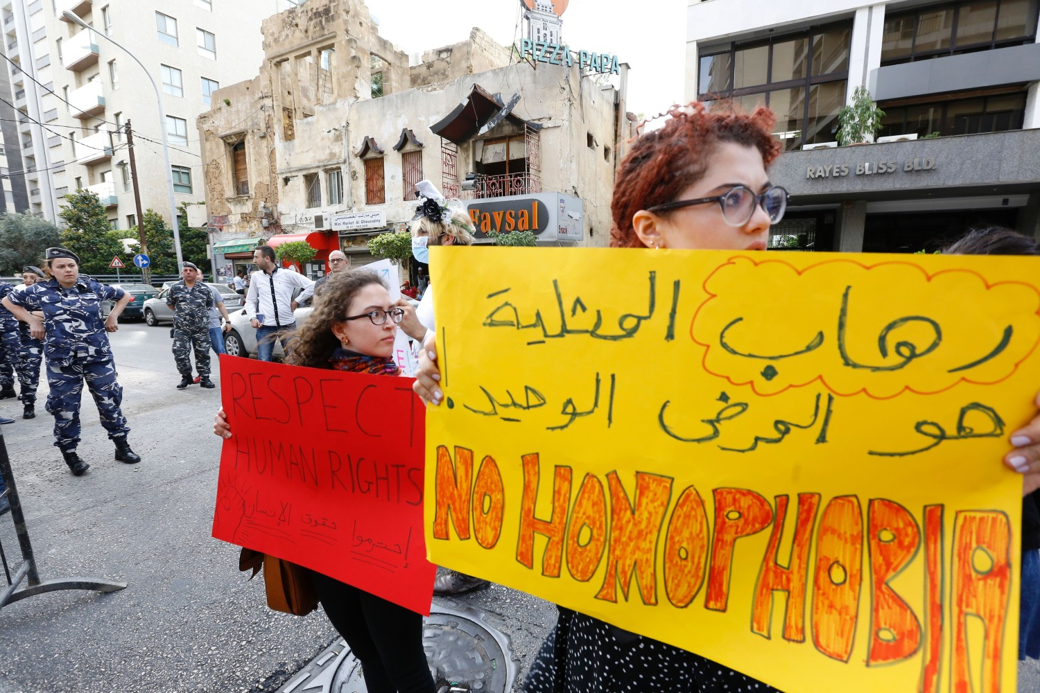 """Activists from of the lebanese LGBT community take part in a protest outside the Hbeish police station in Beirut on May 15, 2016, demanding the release of four transsexual women and calling for the abolishment of article 534 of the Lebanese Penal code, which prohibits having sexual relations that """"contradict the laws of nature"""". / AFP / European Commission / ANWAR AMRO (Photo credit should read ANWAR AMRO/AFP/Getty Images)"""