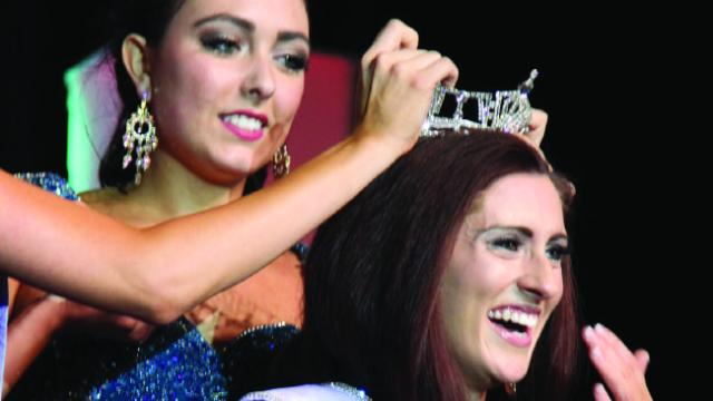 Openly gay Erin O'Flaherty smiling as she is crowned Miss Missouri