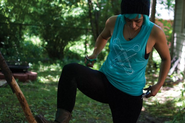 Sarah in that turquoise scissoring muscle tank