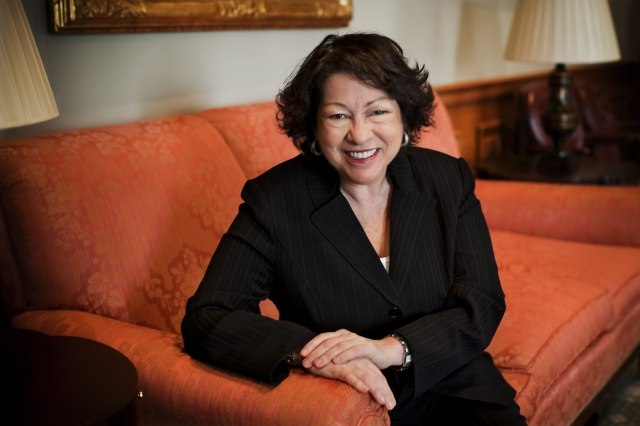 Justice Sonia Sotomayor seated on a couch