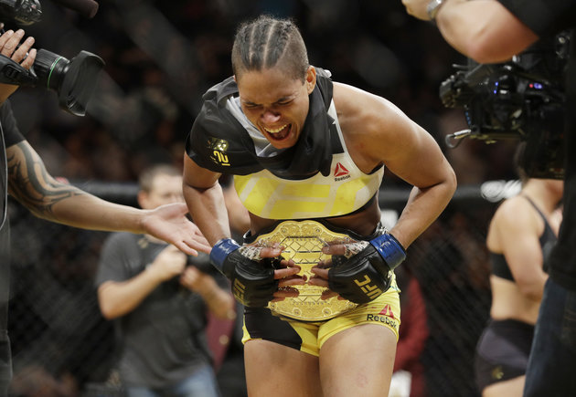 Amanda Nunes celebrates after defeating Miesha Tate during their women's bantamweight championship mixed martial arts bout at UFC 200, Saturday, July 9, 2016, in Las Vegas. (AP Photo/John Locher)