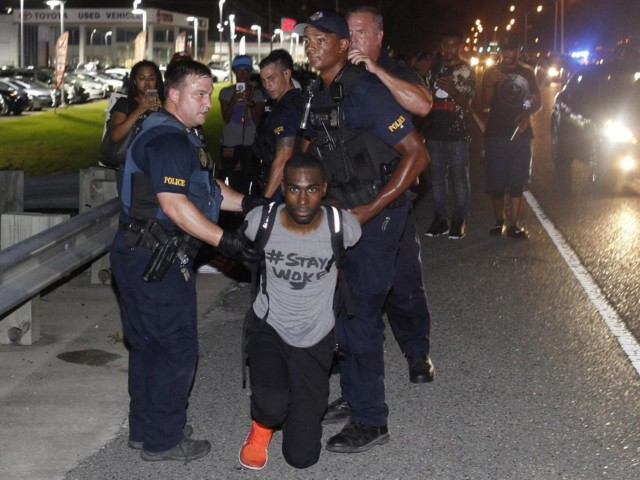 DeRay Mckesson being arrested by police in Louisiana as onlookers film with phones