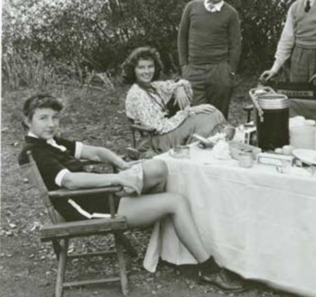 Laura Harding (Katherine Hepburn is sitting behind her)
