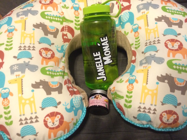 Breastfeeding must-haves: my Boppy pillow, a lot of H2O, and nipple butter.