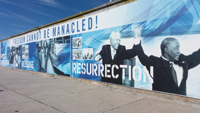 "A mural on Robben Island featuring phrases like ""Resurrection,"" ""Release,"" and ""Freedom cannot be manacled."""