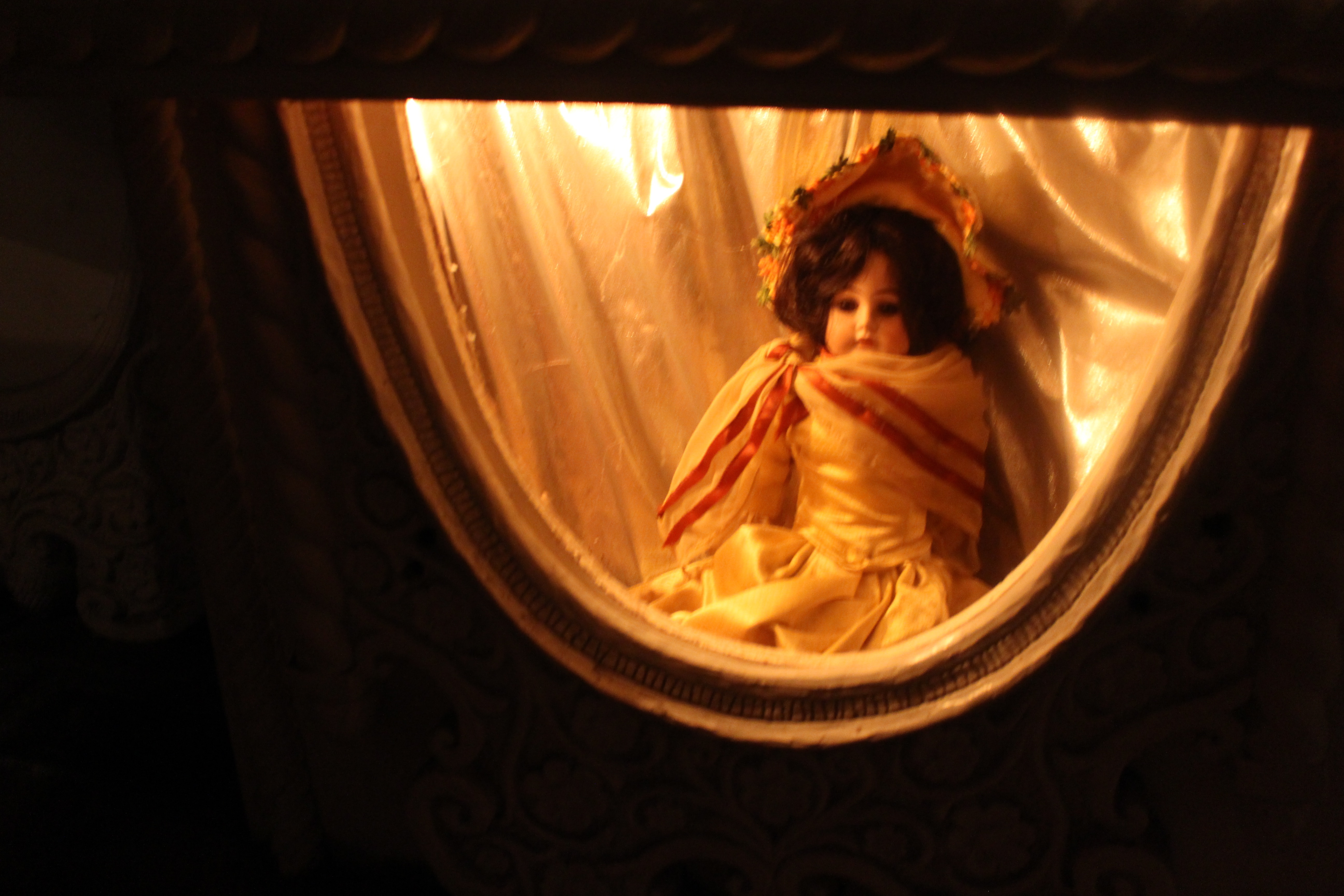 why is this doll trapped in this tiny room??