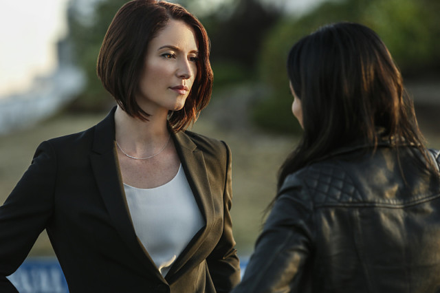 "Supergirl -- ""Welcome to Earth"" -- Image SPG203b_0190 -- Pictured (L-R): Chyler Leigh as Alex Danvers and Floriana Lima as Maggie Sawyer -- Photo: Bettina Strauss/The CW -- © 2016 The CW Network, LLC. All Rights Reserved"