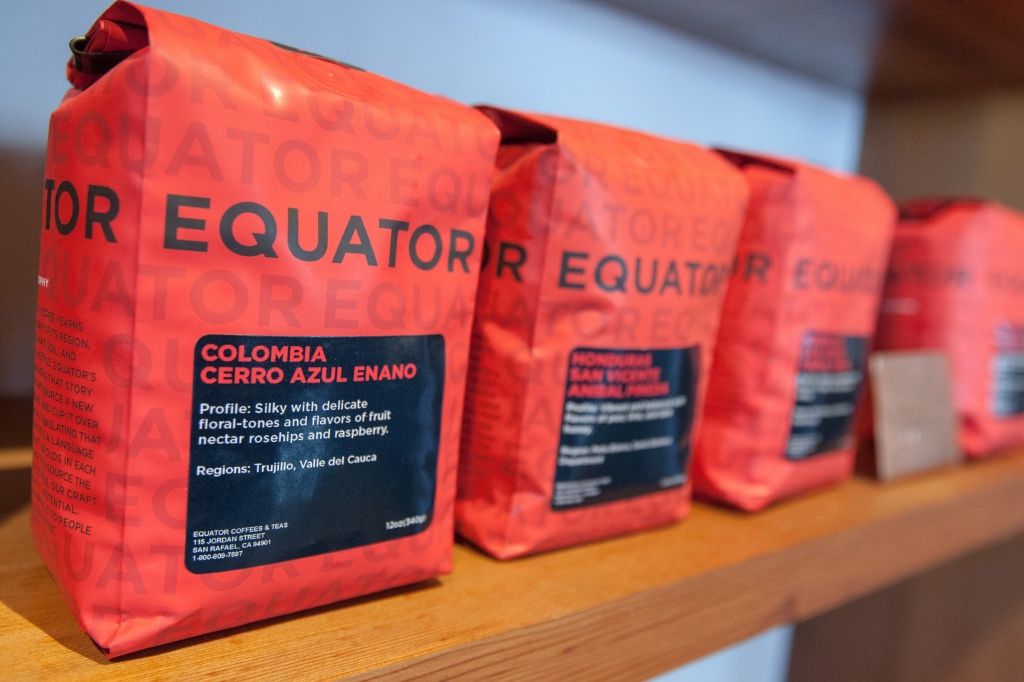 Coffee bags are seen on the shelves at Equator Coffee, Monday, Dec. 14, 2015, in Mill Valley, Calif. The roasters got into retail and are seeing huge growth.