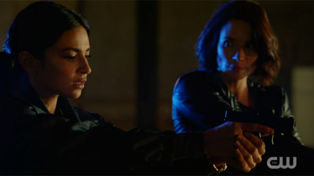Alex and maggie with guns, Alex looking at Maggie