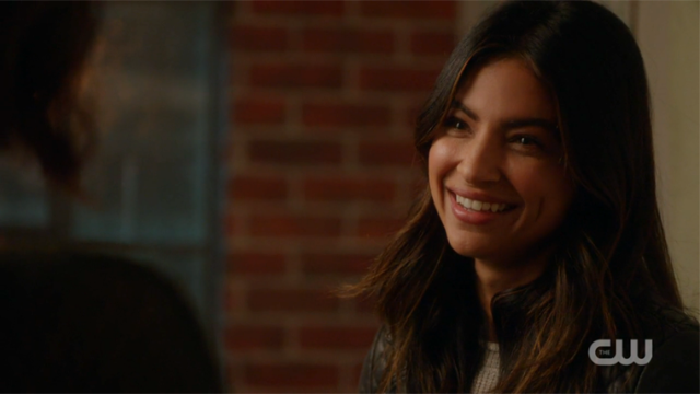 Maggie smiles at Alex.