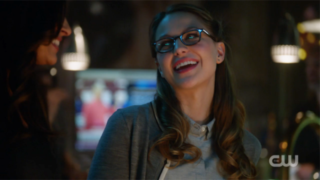 Kara smiles a knowing smile at Maggie.