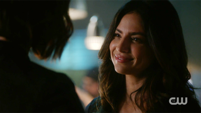 Maggie flashes her dimples at Alex.