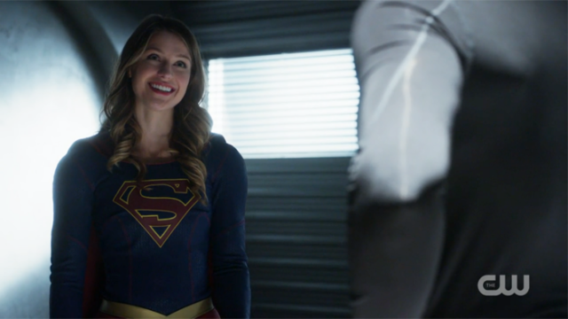 Supergirl beams at J'onn.