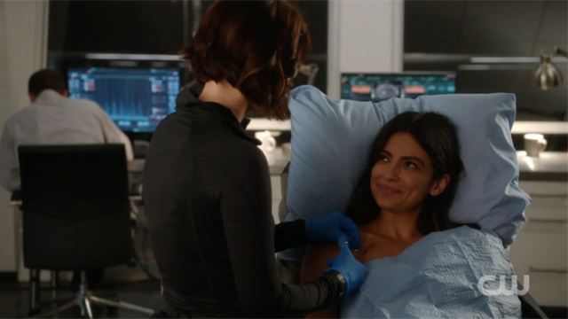 Alex patches Maggie up.