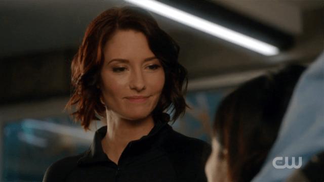 Alex smiles appreciatively at Maggie.