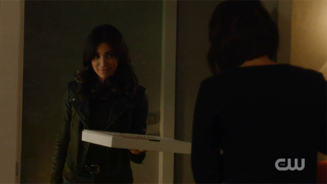 Maggie at Alex's door with a pizza box