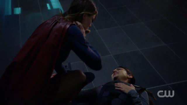 Supergirl checks on an injured Maggie.
