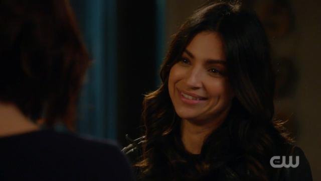 Maggie smiles at Alex